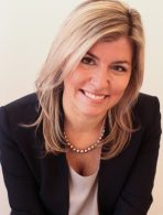 Invest in Others Board Member Meghan Peachey of Natixis Investment Managers